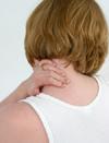 woman rubbing neck
