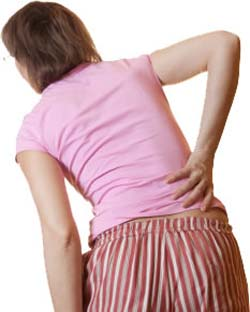 lady leading over in back pain