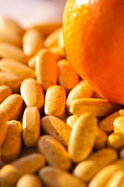 Vitamin C Pills and Orange