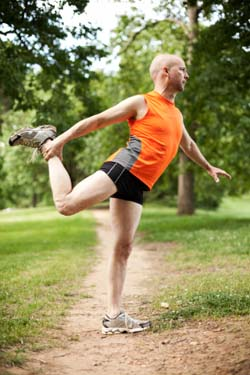 Middle Age man stretching before a jog