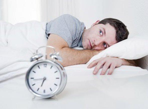 Lying Awake In Bed with Clock